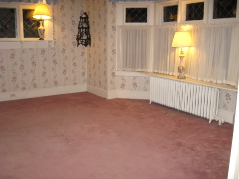 The living room, cleared of furniture