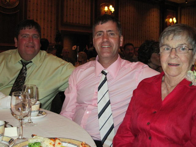 D'Arcy with his mom & brother, Kevin, at the reception