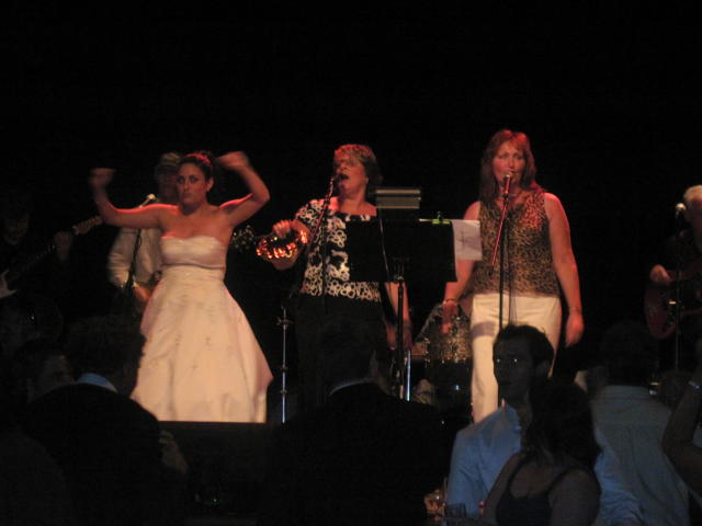 """At midnight, the bride joined the band on stage to sing """"Happy Birthday"""" to the Best Man!"""