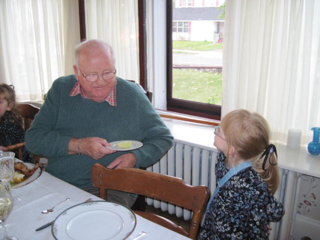 "Sarah, presenting her grandfather with an ""ear"" of corn she'd grown just for him - it was about 5 cm long!"