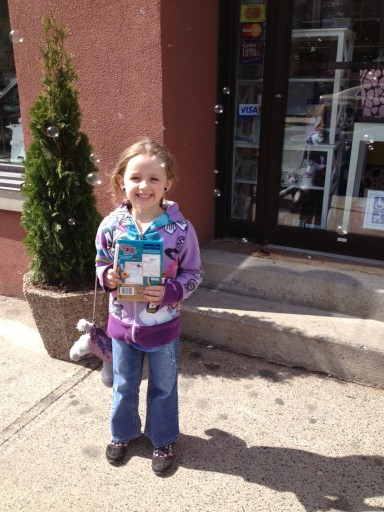 Olivia surrounded by bubbles being blown outside a candy shop in Halifax. Happy her appointment was over.
