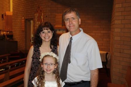 Sarah with her proud parents.