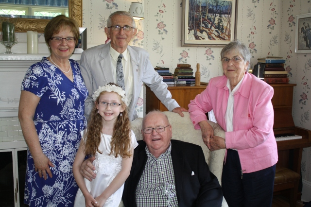 Sarah with both sets of her grandparents.
