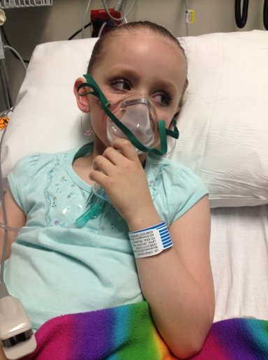 Olivia ended up back in the hospital for a couple of nights with double pneumonia after her dance recital, hence the breathing mask and full makeup!