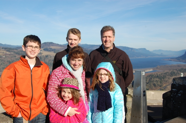 Family shot in the sun and wind, Columbia River in the background.