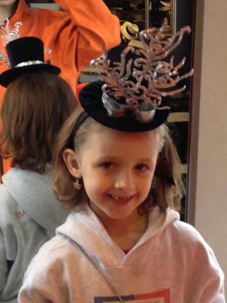 Olivia wearing a New Year's headband.