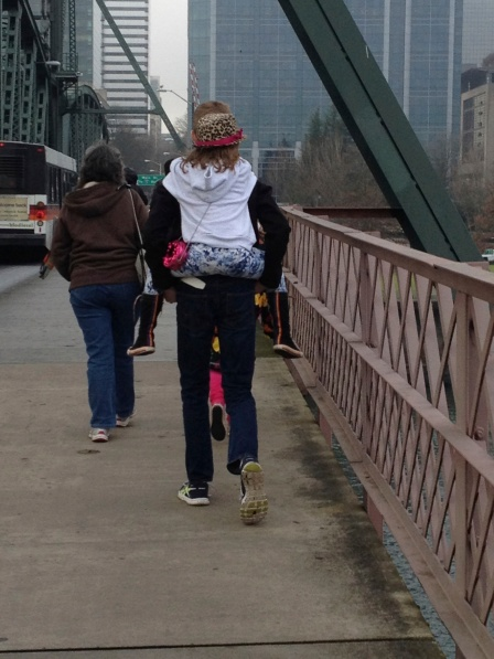 Walking across the drawbridge. Someone gets a lift from her big brother.