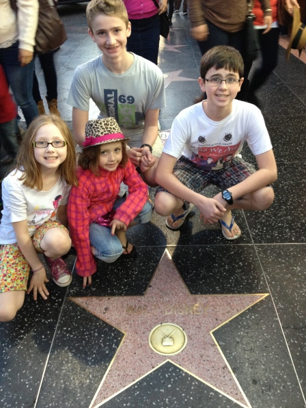 With Walt Disney's Star on the Walk of Fame