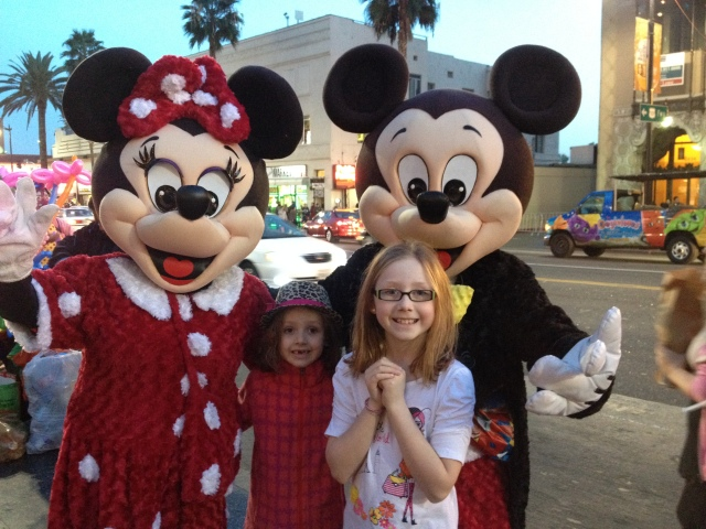 Finally getting their photo with Mickey - although we had to pay $1 for this one!