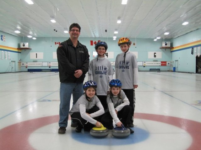 Evan & Alex with teammates Madison & Lindsey, and coach Todd at their first Little Rocks, four years ago.