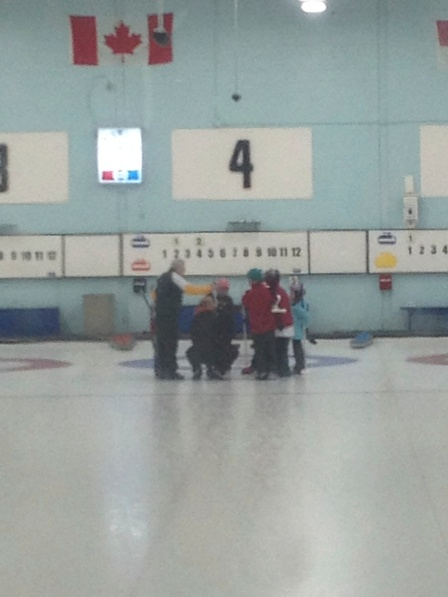 The officials are out on the ice at every game, giving pointers, and stopping the game to teach rules. In this case, the other team threw our rock by mistake. They are learning that they should have let it play, and replaced it when it came to rest.