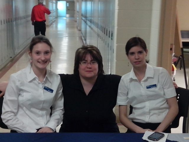 Margaret (Office Admin), Heather (Business Admin), Samantha (Office Admin) at the coat check. Photo credit: Deanna Belliveau, Business Admin