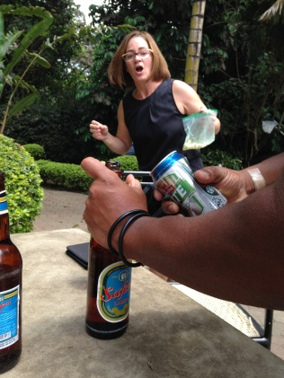 Amy's hilarious reaction to the gym/pool manager opening our beer using a beer can!